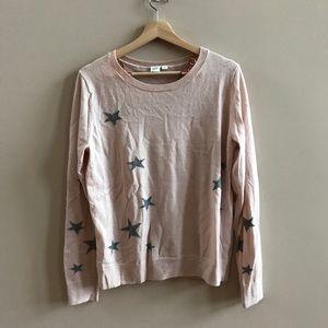 Blush pink sweater with grey stars